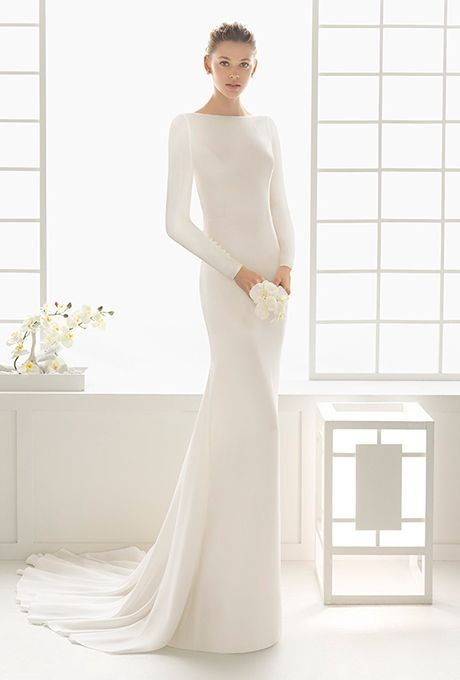 minimalist wedding dress of plain white fabric that reminds of winter snow