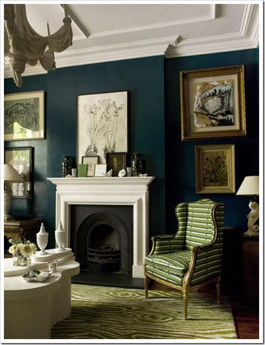 navy walls, grass green louis xvi chair & faux bois rug with bright white accents, including a super mod coffee table.