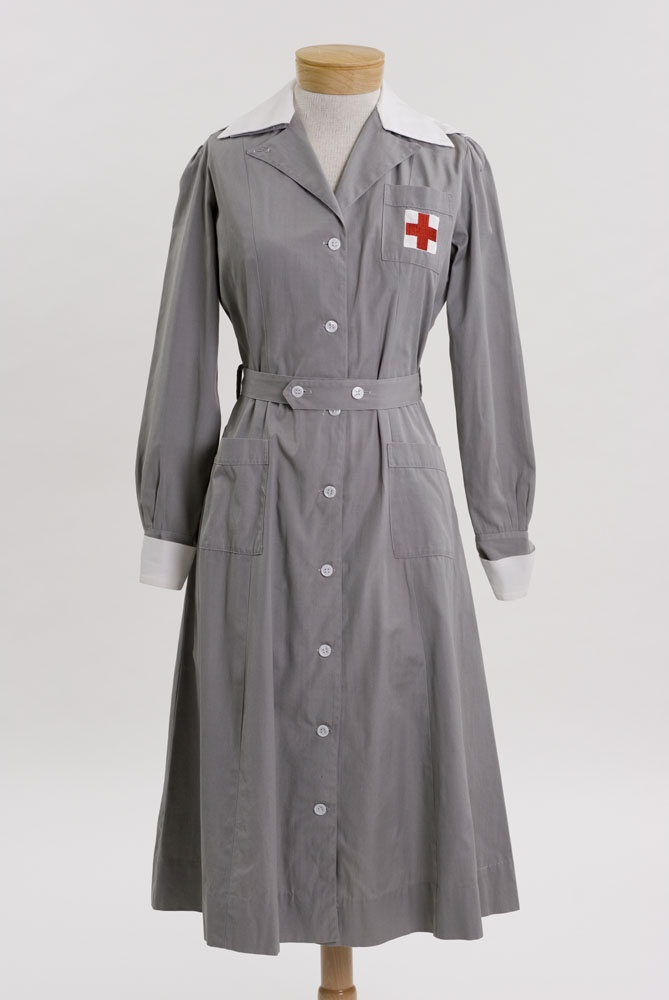 Red Cross Gray Lady dress in dove gray seersucker with removable white collar and cuffs, epaulets, and ten white buttons, circa 1941.