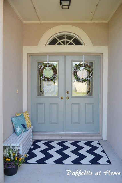 Spring front porch 2, decorated with a painted bench, rug, and wreaths