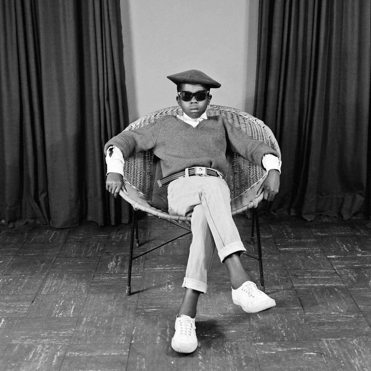 """anotherafrica: """" S. J. Moodley, [Boy with sunglasses in a chair], ca. 1978 Courtesy The Walther Collection Who I Am, an exhibition at The Walther Collection Project Space, New York on Rediscovered..."""