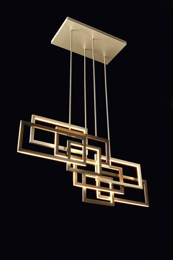 Edge pendant lamp by Oasis, design by Massimiliano Raggi. LED lights diffused by a structure of aluminum, bronze and antiqued gold.