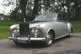 Google Image Result for http://www.sussexbridalcars.co.uk/images/fleet/classic_vintage_saloons/65_rolls_royce_silver_cloud.jpg