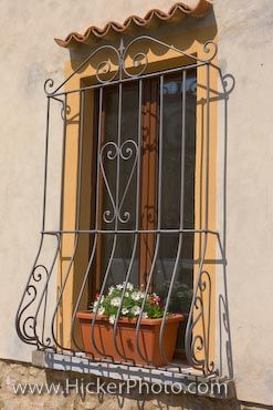 Barred Window Picture Volterra Tuscany Italy: This style of Barred window is a common sight in the city of Volterra, Tuscany in Italy, and are used as much for decoration as for security. If 'the eyes are the windows of the soul', so conversely it seems that 'windows are the eyes of a city'. In the city of Volterra, Tuscany in Italy, there are many styles of windows, one of them being the barred window. The bars can be for decoration or protection, but the different designs of the ironwork…