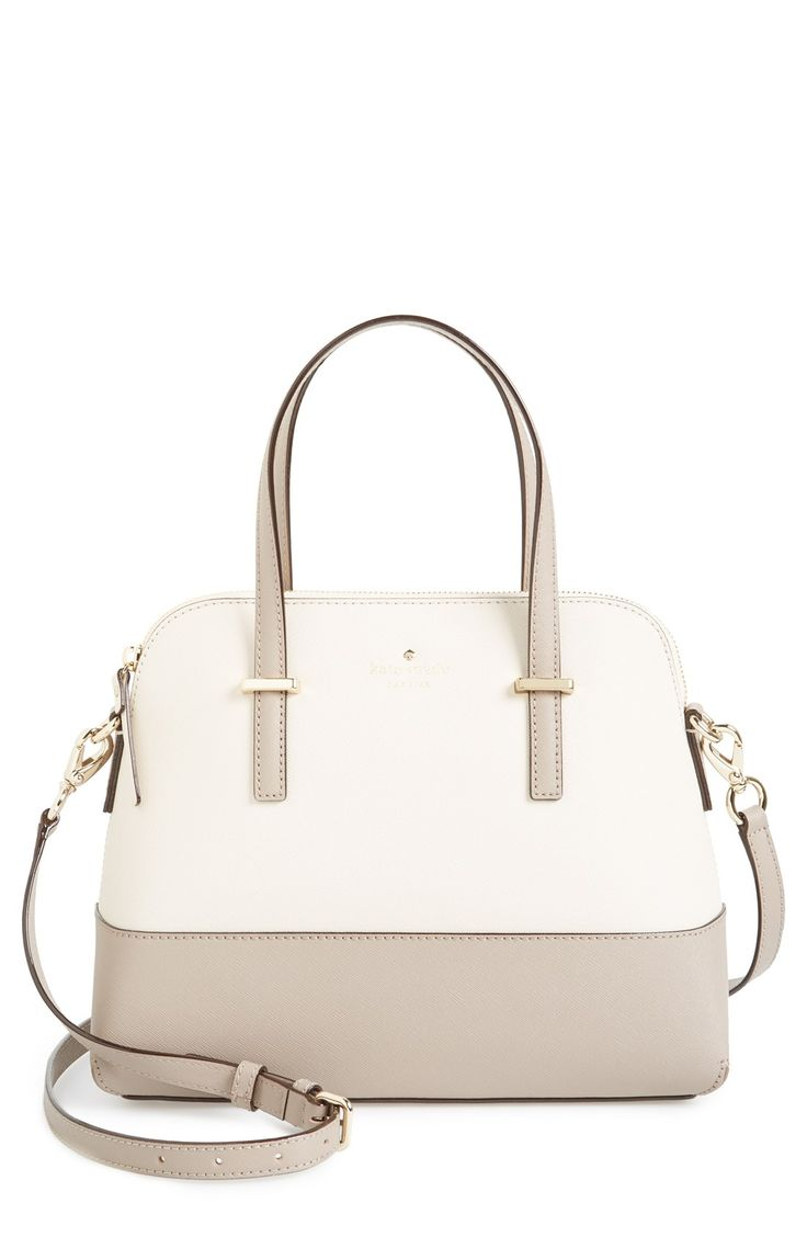 This lavish Kate Spade satchel comes with an optional strap that adjusts to the perfect length for crossbody convenience.