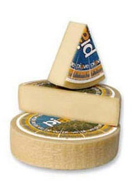 """Piave Cheese Fresco DOP. Price per 3.5/lb quarter wheel. Piave Cheese Fresco DOP Cooked paste cheese with pressed structure and delicate, enjoyable taste. In the """"Fresh Piave"""" typology, the characteristics of this cheese, have not reached their peak and full development which improve with ripening, acquiring a more intense and full-bodied taste. Its aroma recalls yogurt and milk. Its taste is predominately sweet."""