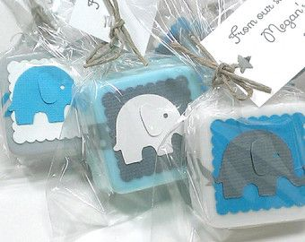 Elephant baby shower favors, made with handmade shea butter mini soaps. They are shown in blue, green and aqua in the main picture but are available to match any color theme. These soaps measure approximately 1 1/4 across and are about 1/2 thick. They weigh approximately 1 oz each. Each favor comes with an ingredients label so your guests know what is in their soap. These are also available in 2-4 ounce soaps. (message me for more info)  --Orders of 36+ come packaged in nice boxes y...