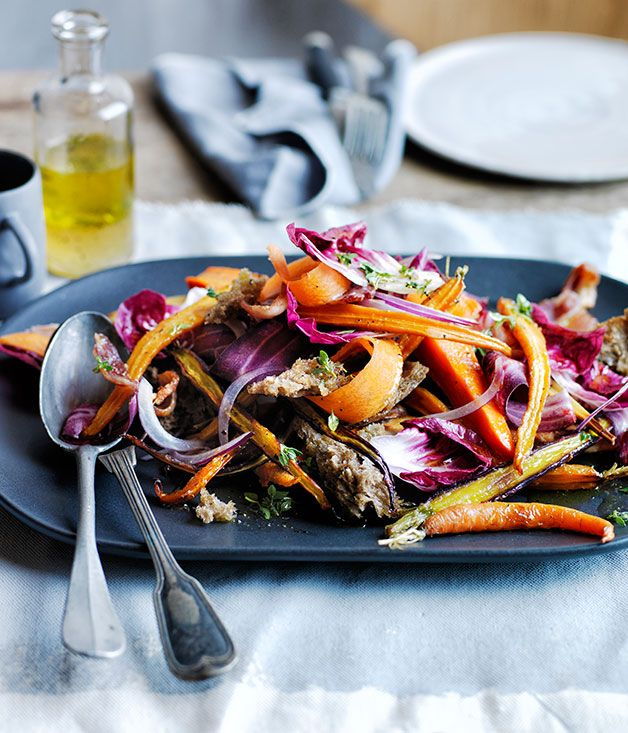 Recipe for warm roast carrot and parsnip salad with rye croûtons.
