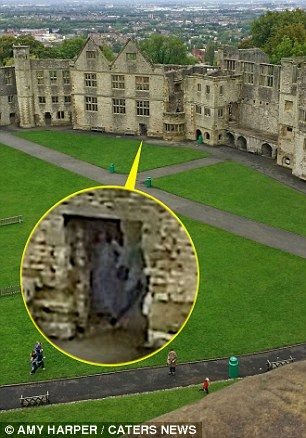 Chilling image of 'Grey Lady ghost' captured in archway by couple visiting courtyard at castle claimed to be most haunted in England