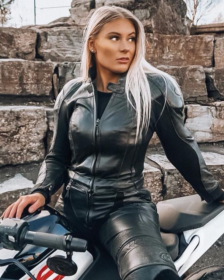 Blonde in black leather, sex position thumbs