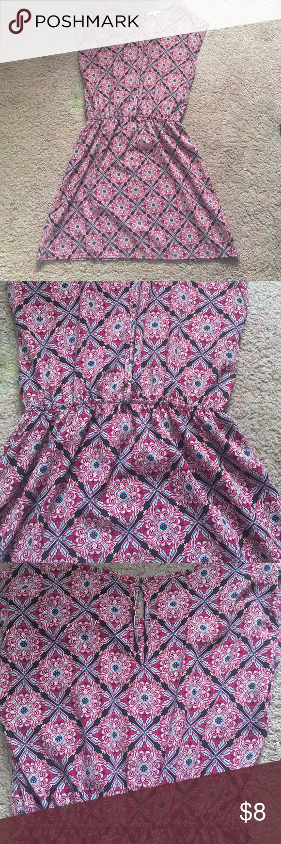 Charlotte Russe Printed Dress This dress is perfect for an event! It's has great colors, get light weight and has a nice flow. It has cut off sleeves and sinches at the waist giving you a nice curve! Charlotte Russe Dresses