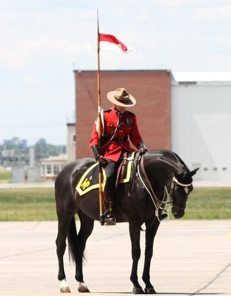 Mountie and his horse taking a moment to reflect