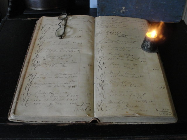 Love this early ledger and tin traveling candle light!