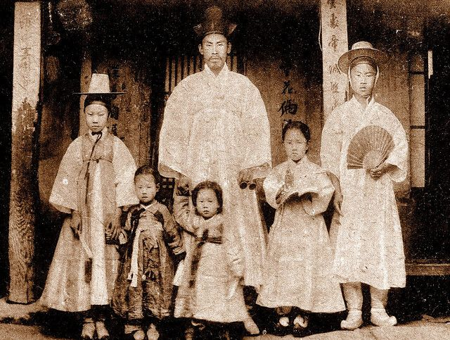 Six members of an upper class family pose for a portrait. Korea, 1900s