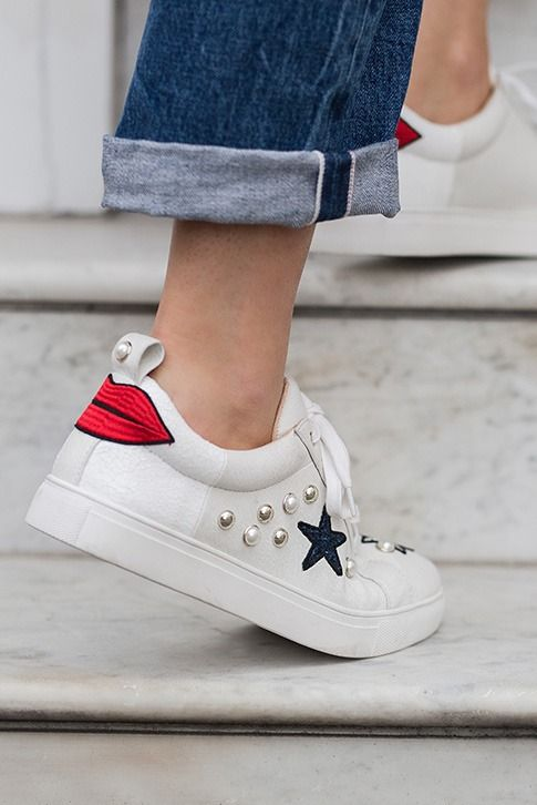 White Lace Up Trainers.  Throw out your tired low-tops and upgrade to Lippy from Miss KG. Designed to make a casual statement, this fresh design features a crisp white leather upper with lip and star appliqués and studwork to finish the whole package.