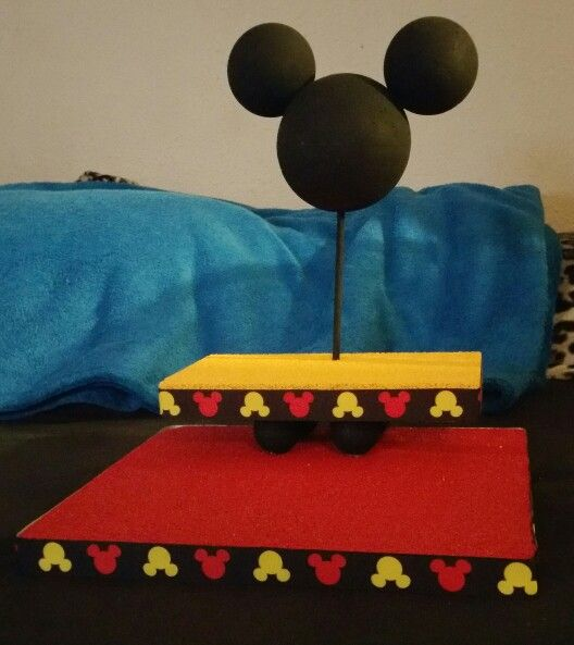 Mickey mouse cake pop stand using foam board and balls from my local dollar store, ribbon from Michaels craft store, and paint from Walmart