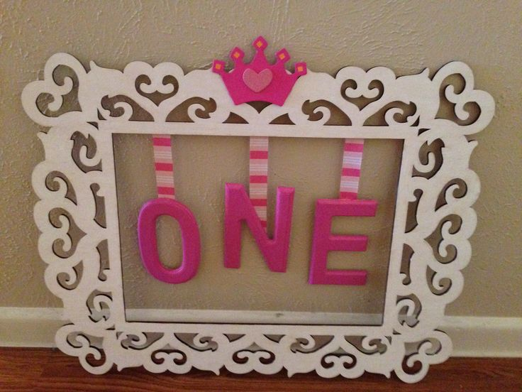 Easy DIY project. Purchased wooden empty frame, letters, and tiara all at Michaels. Painted the frame white and letters pink with multi-surface acrylic paint. Then got out my handy glue gun and put it all together! You can use it for a photo shoot or decor at your Princess' birthday party!