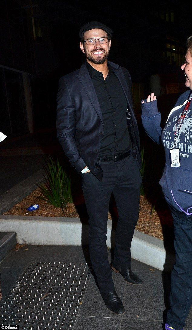 Out after dark! Twilight's brooding Kellan Lutz cloaks his herculean physique in slick suit as he heads to a Sydney footy match on Saturday night