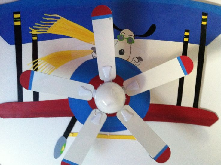 Snoopy's plane painted on the ceiling with the ceiling fan as the propeller.