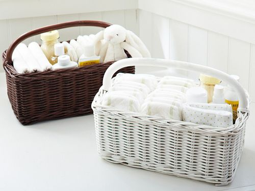 Keep changing table essentials tidy and attractive with a sweet storage solution, like this wicker basket diaper caddy.
