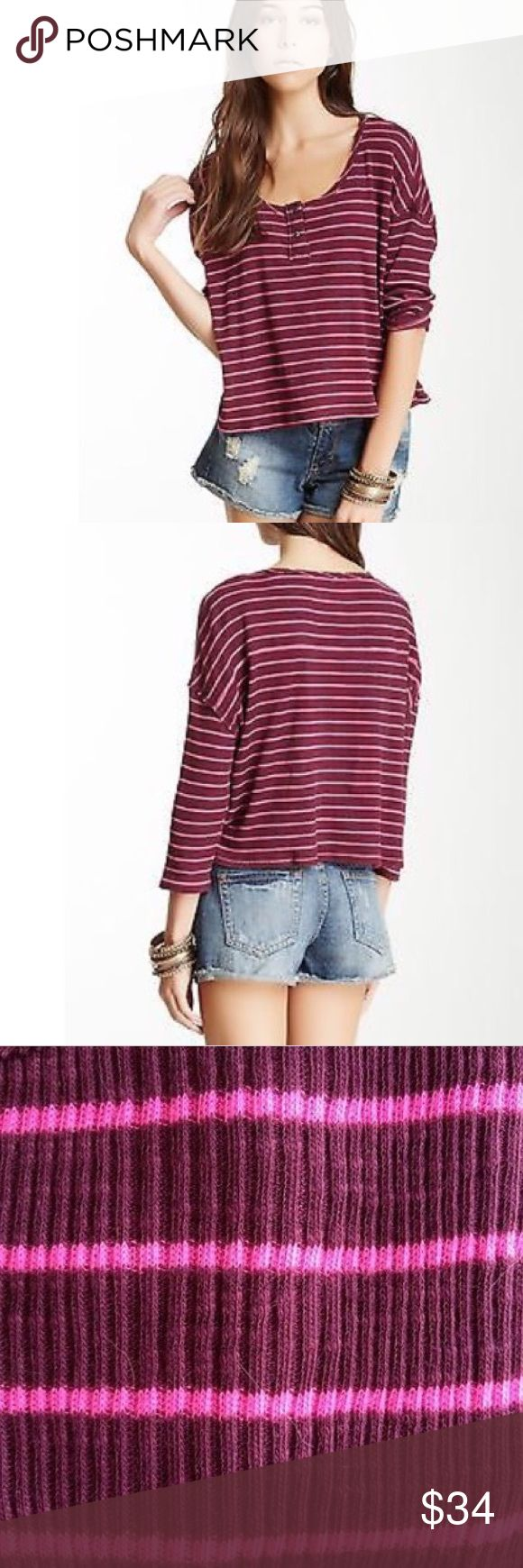 Free People Garvey Stripe Cotton Henley Top This is a Free People Garvey Stripe Cotton Henley Top in Plumberry/Shocking Pink Combo. Size: L. MSRP $68. NWT. * Drop-shoulder seam. * Cropped cotton-poly henley flaunts a boxy silhouette. * Round neck and 3/4 sleeves. * Two- button placket. * Steiped design throughout. * Drop-shoulder detailing. * Made of 83% Cotton 17% Polyester  * Machine wash * Imported Free People Tops Crop Tops