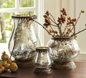 "Mercury glass vases - DIY TIP: To make your own mercury glass simply spritz glass with water then spray with Krylon ""Looking Glass"" spray paint and voila!"