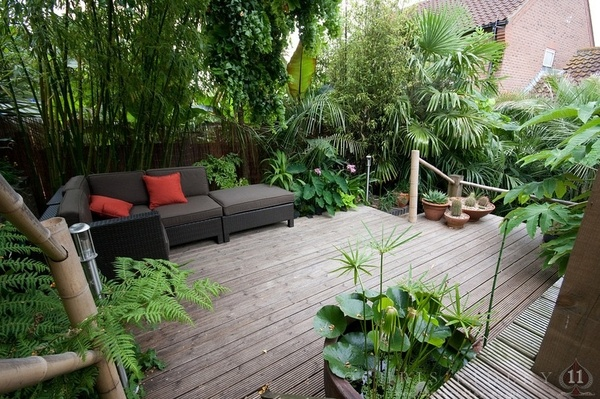 Love the lush tall greenery for privacy. Looks wonderfully natural with the wood deck too. Like how center space remains open and uncluttered.