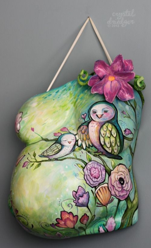 Owl Cast, by Crystal Driedger. The pregnant woman was drawn to owls. I also added a sculpted flower, created from scratch.