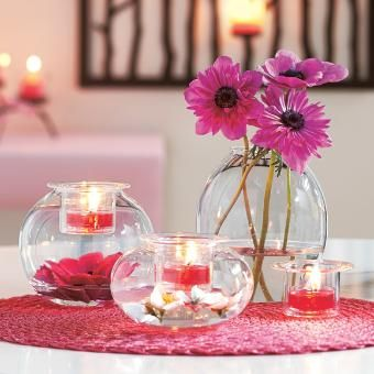 """Three shapely blown glass holders to fill with your own decorative touches! Top with a votive or tealight, sold separately, in the pressed glass votive cup. One each: 5¼"""" (13 cm) h, 4"""" (10 cm) h, 2¾"""" (7 cm) h."""
