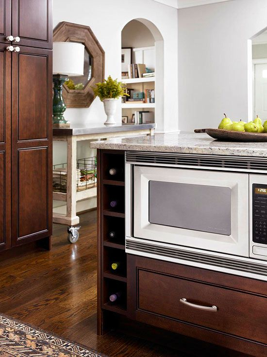 Problem: Cramped counter space.  Solution: Move the microwave below the counter to free up precious work space in a small kitchen.