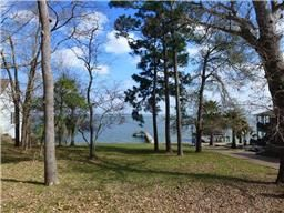 Waterfront home site for sale with pier. Spectacular open water views of Lake Livingston. 611 Kings Way, Coldspring TX  77331
