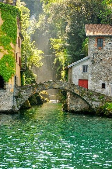 Nesso, Italy: I don't know what is happening behind the scenery and these closed doors, but the landscape is breathtakingly inspiring; Paradise must look like this, if there is any! .