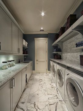 Two washers and two dryers with loads of counter space - this would definitely cut down on time spent doing laundry
