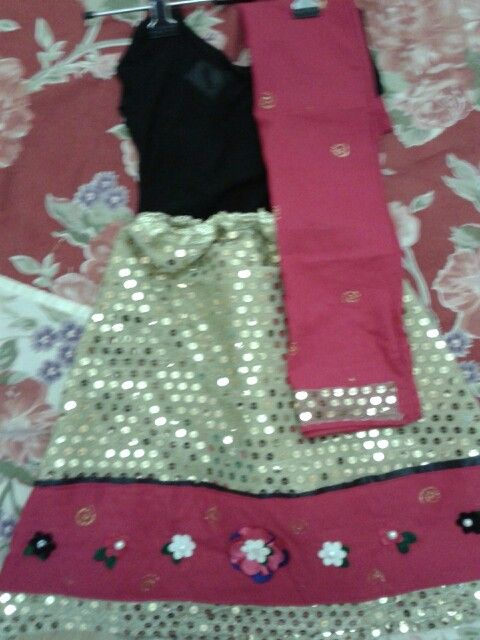 Another dress I made for my doll :) its an ethnic wear .. lehanga chunni for her garba day at school ..