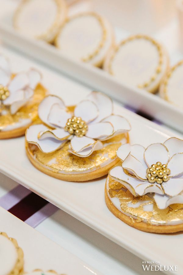 Cookies dusted gold and topped with a delicate blue and gold flower | Wedluxe Magazine #desserttable