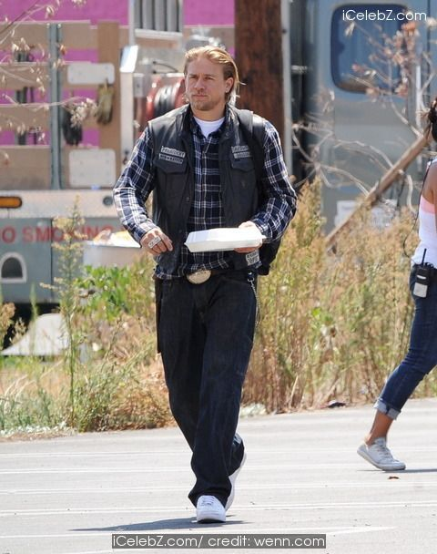 "Charlie Hunnam English actor takes a lunch break from filming one of the last episodes of the hit show ""Sons Of Anarchy"" http://icelebz.com/events/english_actor_charlie_hunnam_takes_a_lunch_break_from_filming_one_of_the_last_episodes_of_the_hit_show_sons_of_anarchy_/photo1.html"