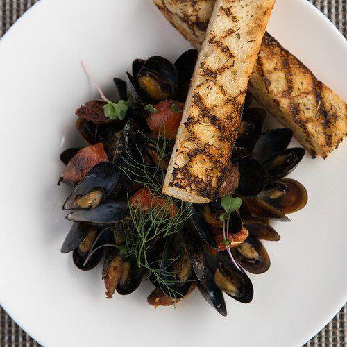Beer braised mussels, andouille sausage, fresh herbs, butter & rustic bread from Glenmorgan Bar & Grill in Wayne, Pennsylvania. http://glenmorgan.com/