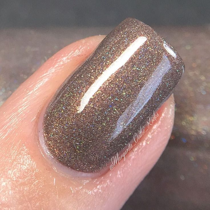 MACRO  Anatares  New from @coloresdecarol Spring Holo collection. A cool brown with scattered holo. Seen here is three thin coats with tc. Dries shiny on its own. Follow @coloresdecarol for updates and link to her shop. Available Now!  by margarita_onthe_rocks