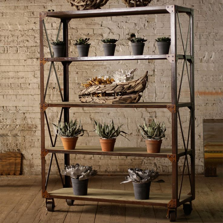 The Rolling Shelving Unit in Iron and Wood looks excellent wherever you put it. But, if you decide you don't like it in the spot you choose, just use the iron casters to move it elsewhere. This shelvin...  Find the Rolling Shelving Unit in Iron and Wood, as seen in the Truth Coffee's Steampunk Revolution Collection at http://dotandbo.com/collections/truth-coffees-steampunk-revolution?utm_source=pinterest&utm_medium=organic&db_sku=101097