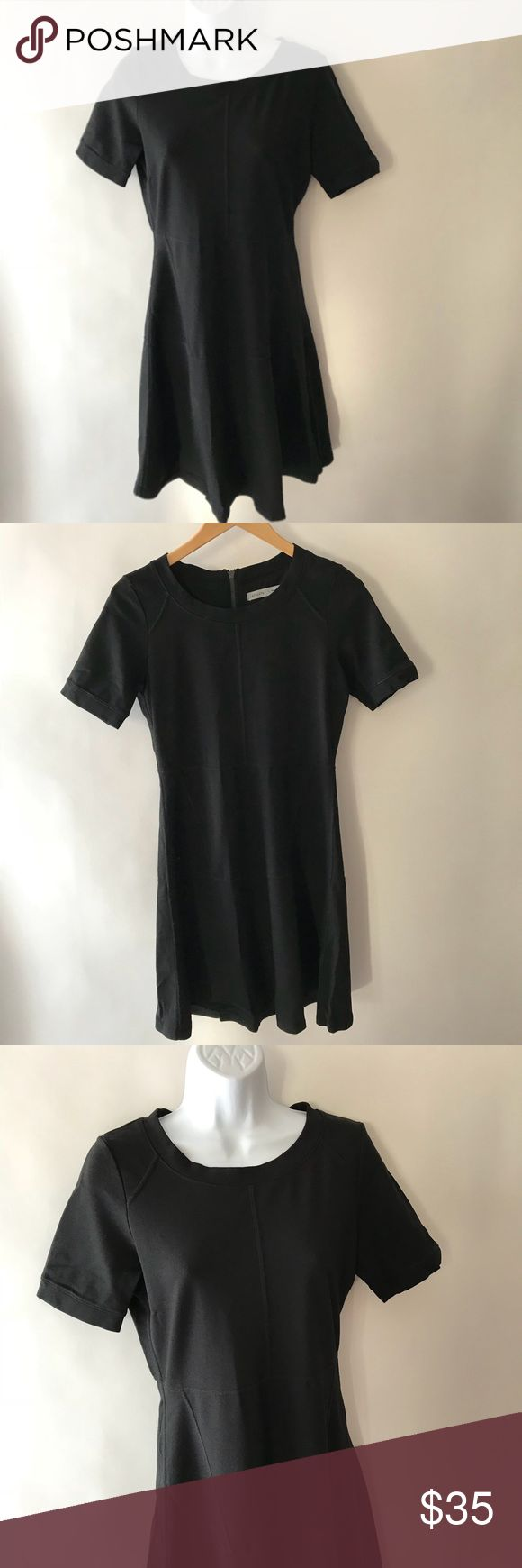 "Athleta En Route Fit & Flare Dress Black Small Athleta En Route Fit & Flare Dress  Color: Black  Size: Small  Exposed Zipper Back  Stretch  Viscose, Rayon, Nylon, Spandex Underarm to Underarm: 17"" Length 36"" Gently Used Pre-Owned Condition   180206-OS1139 Athleta Dresses"