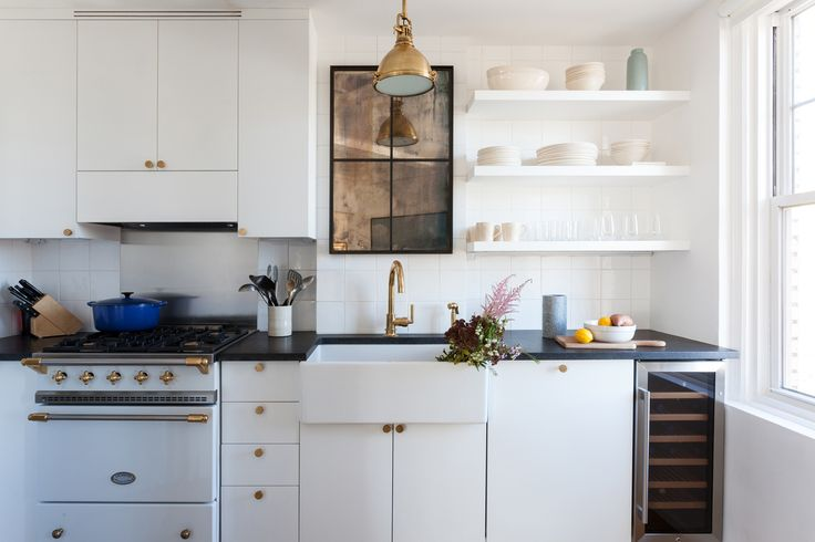 compact kitchen, remodeled by Ashe + Leandro, white cabinets, brass details,  photo by Fran Parente
