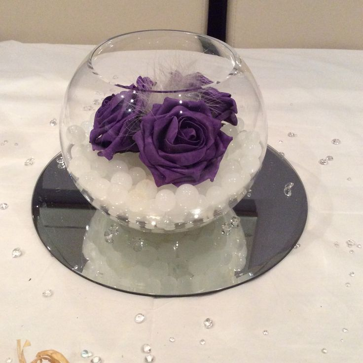 Cadburys purple fishbowl wedding centrepiece www.affinityeventdecorators.com