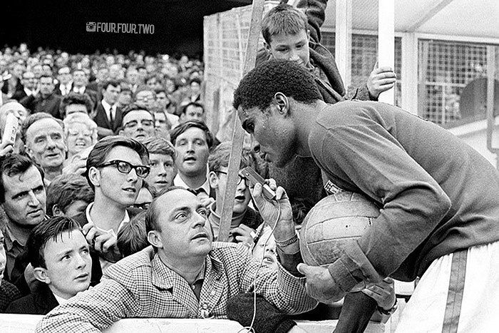 There's something wonderfully innocent about this shot of #Portugal's #Eusebio as he gives an impromptu pitch-side interview in 1966. It wouldn't happen in a million years nowadays. And just look at all the onlookers. I don't think football photographs get much more charming than this. by four.four.two