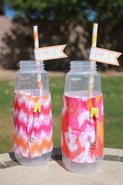Baby Shower Idea ~ serve the guests drinks in baby bottles... wrap coordinating fabric with baby safety pins around bottles, add some matching straws with either cute flags or washabi tape
