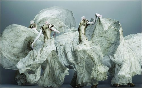 """Alexander McQueen, 2011 exhibition """"Savage Beauty"""" at the Met. Stunning photos by Sølve Sundsbø. The book is a favorite on my book shelf! Live models where painted white with strings tied where a mannequin has joints. Then the photos were digitally edited to enhance the """"mannequin"""" illusion. Had me fooled for awhile."""