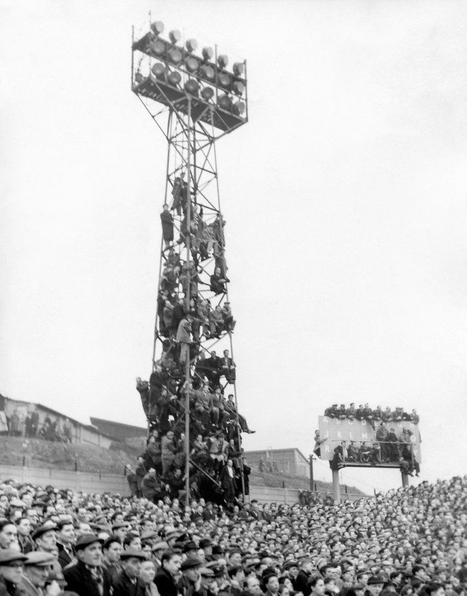 Millwall fans flaunt the Health and Safety regulations to watch their side take on Newcastle at The Den, 1957