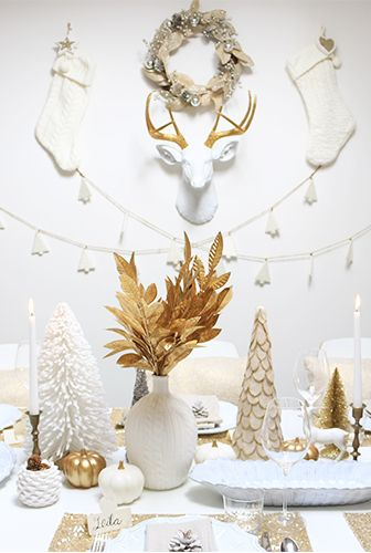 White and gold are nothing but elegant — especially when displayed in multiple seasonal elements, like stockings, wreaths and trees.