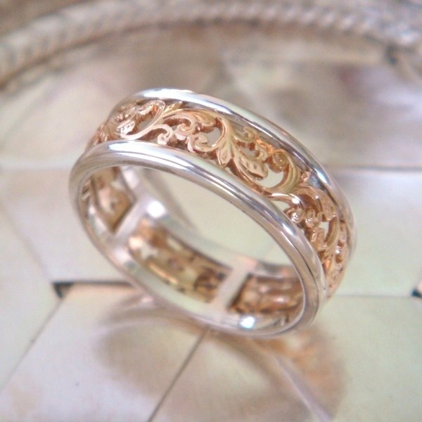 rose gold and sterling silver spinner ring.  would make an amazing wedding band