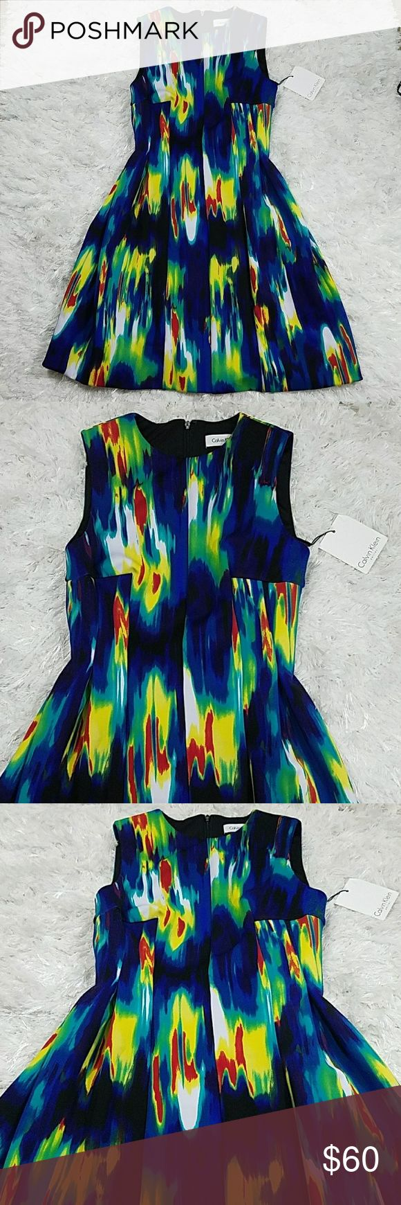 Calvin Klein Petite Size 2 Dress What can I say! Its gorgeous! Size 2 petite  Multicolor with a firm fitted waist then it falls perfect over the hips. Great sturdy material, no see though just great looking dress.  No flaws as seen above, only thing to be honest is that I dont have a lint roller lol other than that its perfect! Calvin Klein Dresses Mini