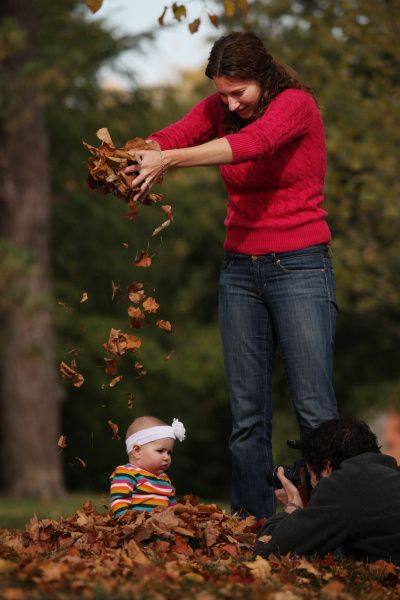 With her mom, Beth Ratajczak, supplying the special effects, Blair poses while her dad, J.P., tries to get the perfect shot. The Ratajczak family was shooting Blair's 6-month portrait yesterday in Schiller Park.   Photo by Dispatch photographer Eric Albrecht